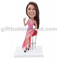 Custom Female Bobblehead Lady in Pink Dress Sitting on Bar Stool with Cocktail in Hand