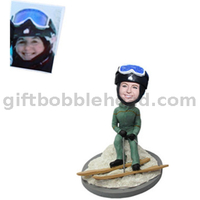 Female Skiing Bobblehead Lady Sitting on The Snowbank 2021