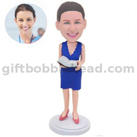 Custom Female Teacher Bobblehead Lady in Blue Dress with Book in Hand